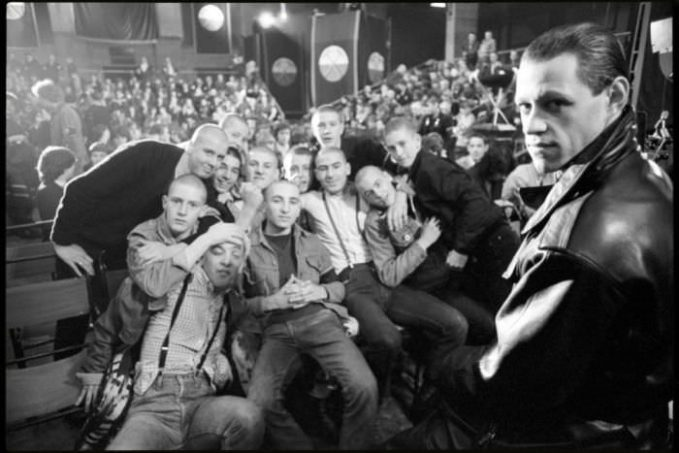 A behind-the-scenes images of Bob Geldof as 'Pink' and actual skinheads from the 1982 film 'Pink Floyd - The Wall.'